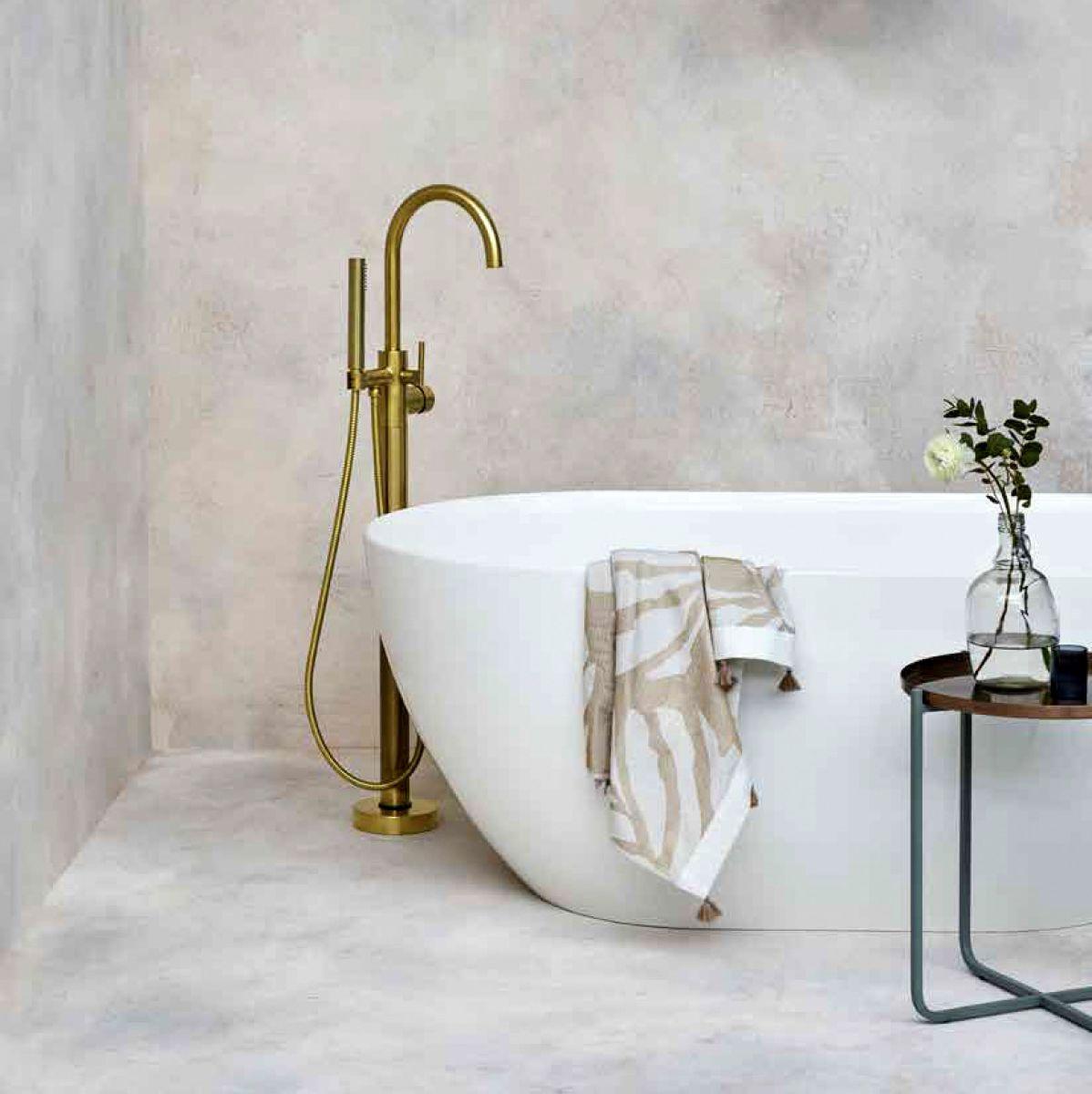 Floor standing bath tap